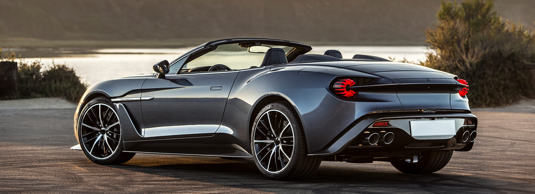 Back and side view of luxury sports car with roof off