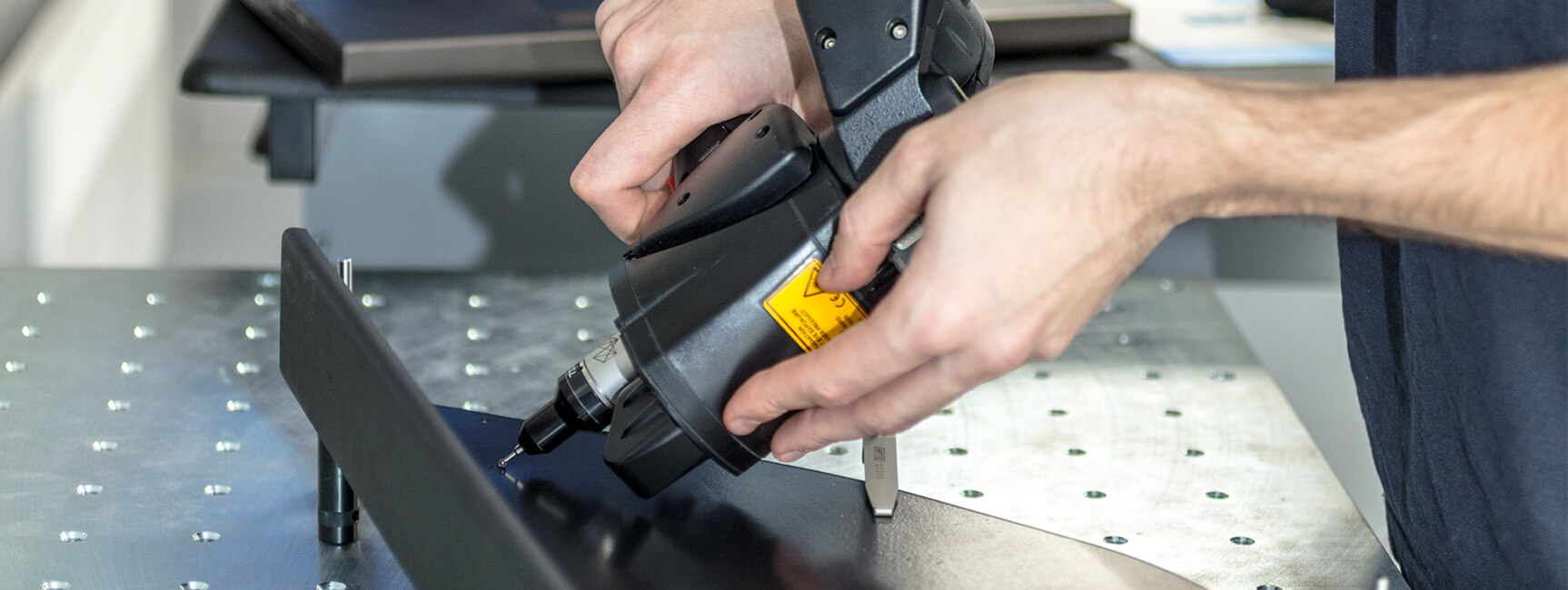Man using tool on product